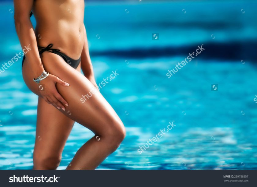 stock-photo-girl-with-beautiful-body-by-the-swimming-pool-259758557