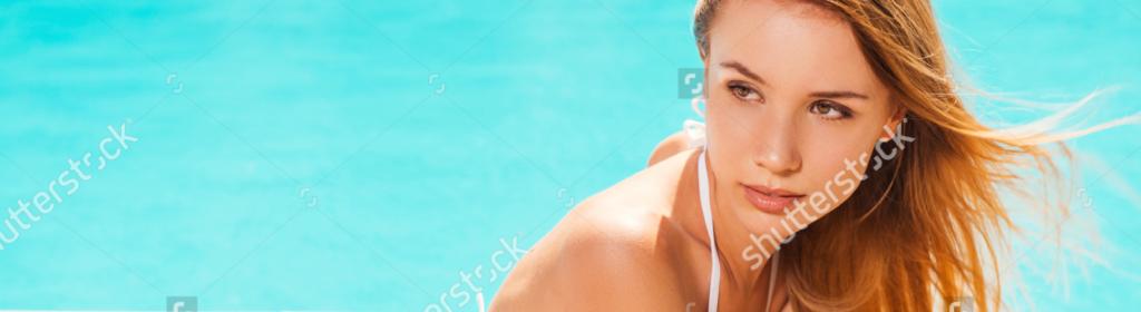 stock-photo-sunbathing-near-the-pool-attractive-young-woman-in-white-bikini-lying-near-the-pool-and-looking-210326134