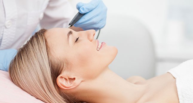 Dr. Scott Bartlett, an award winning Philadelphia plastic surgeon, performs laser resurfacing